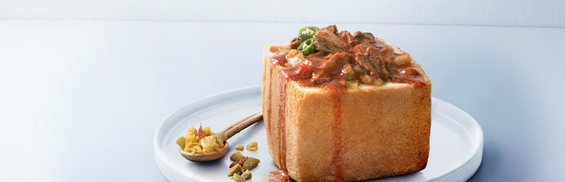 spicy pilchard bunny chow banner